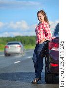 Купить «Девушка в красной рубашке и в каблуках на шпильках стоит возле машины», фото № 23411245, снято 12 августа 2016 г. (c) Кекяляйнен Андрей / Фотобанк Лори