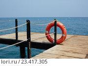 Купить «Red Lifebuoy on wooden pier», фото № 23417305, снято 3 августа 2016 г. (c) Кравецкий Геннадий / Фотобанк Лори