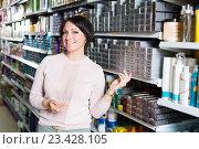 Купить «Female choosing hair dye», фото № 23428105, снято 17 августа 2018 г. (c) Яков Филимонов / Фотобанк Лори