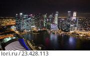 Купить «Ночной вид на небоскребы и морскую бухту азиатского города», видеоролик № 23428113, снято 24 октября 2014 г. (c) Elnur / Фотобанк Лори