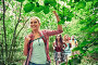 group of smiling friends with backpacks hiking, фото № 23433077, снято 25 июля 2015 г. (c) Syda Productions / Фотобанк Лори