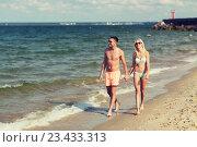 Купить «happy couple in swimwear walking on summer beach», фото № 23433313, снято 11 августа 2015 г. (c) Syda Productions / Фотобанк Лори