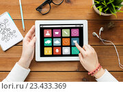 Купить «close up of woman with tablet pc on wooden table», фото № 23433369, снято 22 марта 2016 г. (c) Syda Productions / Фотобанк Лори