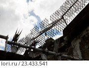 Купить «close up of fence with barbed wire and mesh», фото № 23433541, снято 21 июня 2016 г. (c) Syda Productions / Фотобанк Лори