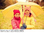 Купить «happy little girls with umbrella in autumn park», фото № 23433985, снято 10 октября 2015 г. (c) Syda Productions / Фотобанк Лори