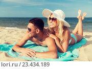 Купить «happy couple in swimwear lying on summer beach», фото № 23434189, снято 11 августа 2015 г. (c) Syda Productions / Фотобанк Лори