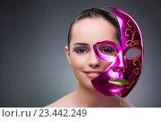 Купить «Young woman with carnival mask», фото № 23442249, снято 13 июля 2016 г. (c) Elnur / Фотобанк Лори