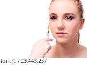 Купить «Young woman preparing for facial treatment isolated on white», фото № 23443237, снято 6 июня 2016 г. (c) Elnur / Фотобанк Лори