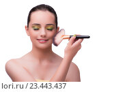 Купить «Young woman during make-up session isolated on white», фото № 23443437, снято 6 июля 2016 г. (c) Elnur / Фотобанк Лори