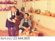 Купить «Cheerful craftsman talking to woman in workroom», фото № 23444869, снято 14 июля 2020 г. (c) Яков Филимонов / Фотобанк Лори