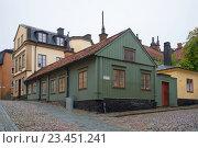 STOCKHOLM, SWEDEN - AUGUST 29, 2016: Corner of old city gloomy rainy day. Стоковое фото, фотограф Виктор Карасев / Фотобанк Лори