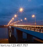 Купить «Юбилейный мост через реку Волга в Ярославле. Ночной вид с подстветкой на фоне грозового неба.», фото № 23457757, снято 20 августа 2016 г. (c) Илья Бесхлебный / Фотобанк Лори