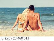 Купить «happy couple in swimwear sitting on summer beach», фото № 23460513, снято 11 августа 2015 г. (c) Syda Productions / Фотобанк Лори