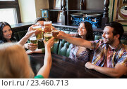 Купить «happy friends drinking beer at bar or pub», фото № 23460713, снято 14 июля 2016 г. (c) Syda Productions / Фотобанк Лори