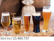 Купить «close up of beer barrel, glasses and bag with malt», фото № 23460737, снято 22 июля 2016 г. (c) Syda Productions / Фотобанк Лори