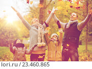 Купить «happy family playing with autumn leaves in park», фото № 23460865, снято 12 октября 2014 г. (c) Syda Productions / Фотобанк Лори