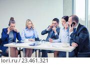 Купить «business team with smartphones having conversation», фото № 23461321, снято 9 ноября 2013 г. (c) Syda Productions / Фотобанк Лори