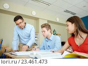 Купить «teacher helping students with task at school», фото № 23461473, снято 22 апреля 2016 г. (c) Syda Productions / Фотобанк Лори