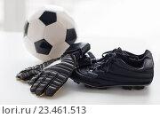 Купить «close up of soccer ball, boots and gloves on table», фото № 23461513, снято 17 июня 2016 г. (c) Syda Productions / Фотобанк Лори