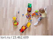 Купить «Маленький белокурый малыш играет с красочными кубиками, вид сверху», фото № 23462609, снято 3 сентября 2016 г. (c) Андрей Кузьмин / Фотобанк Лори
