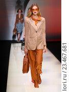 Купить «MILAN, ITALY - SEPTEMBER 25: A model walks the runway during the Emporio Armani show as a part of Milan Fashion Week Spring/Summer 2016 on September 25, 2015 in Milan, Italy.», фото № 23467681, снято 25 сентября 2015 г. (c) Anton Oparin / Фотобанк Лори
