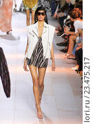 Купить «MILAN, ITALY - SEPTEMBER 26: A model walks the runway during the Roberto Cavalli fashion show as part of Milan Fashion Week Spring/Summer 2016 on September 26, 2015 in Milan, Italy.», фото № 23475217, снято 26 сентября 2015 г. (c) Anton Oparin / Фотобанк Лори