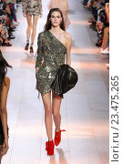 Купить «MILAN, ITALY - SEPTEMBER 26: A model walks the runway during the Roberto Cavalli fashion show as part of Milan Fashion Week Spring/Summer 2016 on September 26, 2015 in Milan, Italy.», фото № 23475265, снято 26 сентября 2015 г. (c) Anton Oparin / Фотобанк Лори