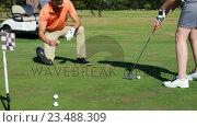 Купить «Golfers playing golf », видеоролик № 23488309, снято 22 июля 2019 г. (c) Wavebreak Media / Фотобанк Лори
