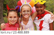 Купить «Kids in various costumes celebrating birthday», видеоролик № 23488889, снято 22 мая 2019 г. (c) Wavebreak Media / Фотобанк Лори