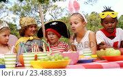 Купить «Group of kids in various costumes having breakfast», видеоролик № 23488893, снято 16 июля 2019 г. (c) Wavebreak Media / Фотобанк Лори