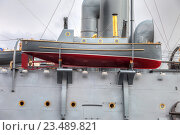 Купить «Lifeboat of the legendary revolutionary cruiser Aurora at the place of eternal parking on the Petrograd embankment», фото № 23489821, снято 29 июля 2016 г. (c) FotograFF / Фотобанк Лори