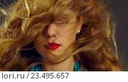 Купить «Portrait of girl with blowing hair in wind. Slow motion.», видеоролик № 23495657, снято 27 августа 2016 г. (c) Gennadiy Poznyakov / Фотобанк Лори