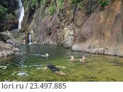 Купить «Водопад Khlong Phlu в Национальном парке Му Ко Чанг. Таиланд», фото № 23497885, снято 26 августа 2016 г. (c) Natalya Sidorova / Фотобанк Лори