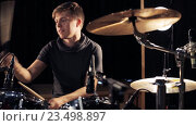Купить «male musician playing drums and cymbals at concert», видеоролик № 23498897, снято 25 августа 2016 г. (c) Syda Productions / Фотобанк Лори