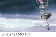 Купить «Man traveling in aerostat . Mixed media», фото № 23500169, снято 25 марта 2014 г. (c) Sergey Nivens / Фотобанк Лори