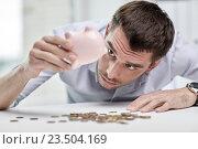 Купить «businessman with piggy bank and coins at office», фото № 23504169, снято 18 июня 2015 г. (c) Syda Productions / Фотобанк Лори