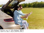Купить «happy man and woman with road map at hatchback car», фото № 23504361, снято 12 июня 2016 г. (c) Syda Productions / Фотобанк Лори