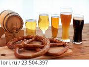Купить «close up of beer glasses, barrel and pretzels», фото № 23504397, снято 22 июля 2016 г. (c) Syda Productions / Фотобанк Лори
