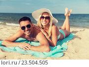 Купить «happy couple in swimwear lying on summer beach», фото № 23504505, снято 11 августа 2015 г. (c) Syda Productions / Фотобанк Лори