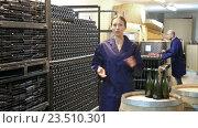 Купить «woman standing indoors on small wine manufacturing», видеоролик № 23510301, снято 7 сентября 2016 г. (c) Яков Филимонов / Фотобанк Лори