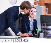 Купить «Playful chief flirting with positive employee», фото № 23521429, снято 21 сентября 2019 г. (c) Яков Филимонов / Фотобанк Лори