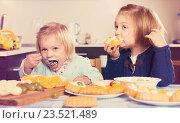 Купить «Two little girls with cream desserts», фото № 23521489, снято 14 декабря 2018 г. (c) Яков Филимонов / Фотобанк Лори