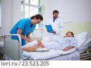 Купить «Nurse bandaging leg of patient», фото № 23523205, снято 17 октября 2018 г. (c) Wavebreak Media / Фотобанк Лори