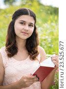 Купить «Romantic girl reading a book on nature», фото № 23525677, снято 8 июля 2016 г. (c) Володина Ольга / Фотобанк Лори