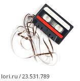 Купить «Аудиокассета с пленкой на белом фоне», фото № 23531789, снято 2 января 2012 г. (c) Александр Лычагин / Фотобанк Лори
