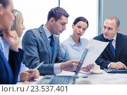 Купить «business team with laptop having discussion», фото № 23537401, снято 9 ноября 2013 г. (c) Syda Productions / Фотобанк Лори