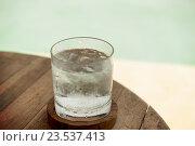 Купить «glass of water with ice cubes on table at beach», фото № 23537413, снято 15 февраля 2015 г. (c) Syda Productions / Фотобанк Лори