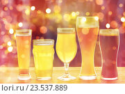 Купить «close up of different beers in glasses on table», фото № 23537889, снято 22 июля 2016 г. (c) Syda Productions / Фотобанк Лори