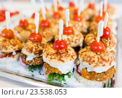 close up of canape hamburgers on serving tray. Стоковое фото, фотограф Syda Productions / Фотобанк Лори