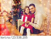 Купить «smiling father and daughter holding gift box», фото № 23538205, снято 26 октября 2013 г. (c) Syda Productions / Фотобанк Лори